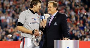 Tom Brady of the New England Patriots being interviewed by Jim Nantz. Photograph: Jim Rogash/Getty Images