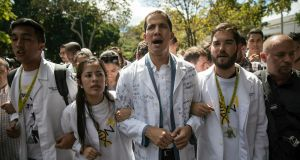 Opposition National Assembly leader Juan Guaidó, who declared himself interim president of Venezuela last week, taking part in a protest against Nicholás Maduro in Caracas on  Wednesday. Photograph: Rodrigo Abd/AP