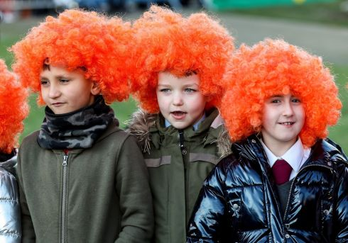 SHEER LUKE: Pupils from St Laurence O'Toole wear wigs at the unveiling of the Luke Kelly sculpture at Guild Street, Dublin. Photograph: Maxwell's