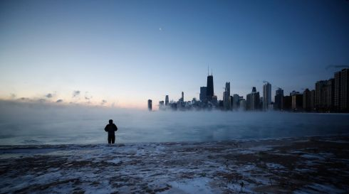 CHILL OUT: A man walks on North Avenue Beach as the sun rises over Lake Michigan in Chicago, US, amid a polar vortex that has sent temperatures plummeting. Photograph: Kamil Krzaczynski/EPA