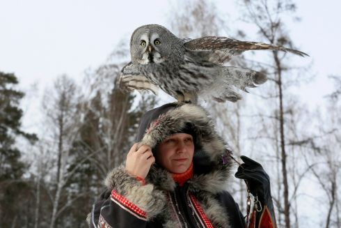 BIRD-BRAINED: Mykh, a two-year-old great grey owl, sits on the head of ornithologist Daria Koshcheyeva during a training session, in Krasnoyarsk, Russia. Photograph: Ilya Naymushin/Reuters