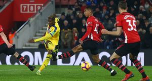 Wilfried Zaha scores  for Crystal Palace  during the Premier League match against  Southampton  at St Mary's Stadium. Photograph:  Jordan Mansfield/Getty Images