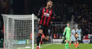 Bournemouth's Joshua King celebrates scoring their third goal as Chelsea's Kepa Arrizabalaga and team-mates look dejected. Photograph: Hannah McKay/Reuters