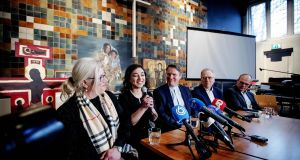Armenian Hayarpi Tamrazyan (second left) speaks during a press conference in Bethel Church on Wednesday after a continious church services was stopped. Photograph: Robin Van Lonkhuijsen/AFP/Getty Images