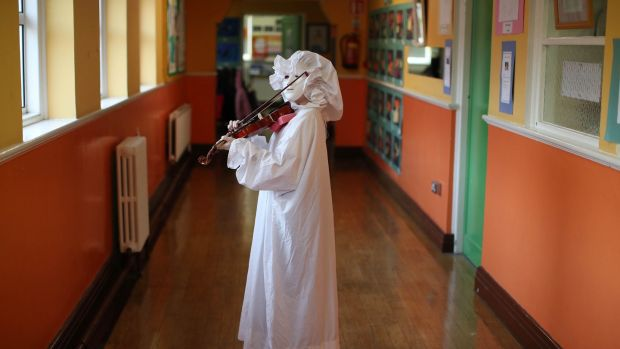 Zach Elliott, from Scoil Úna Naofa Violin and Orchestra Project, rehearses his role of the ghost in 'There's A Ghost in My Living Room'. Photograph: Marc O'Sullivan