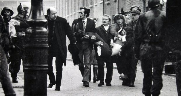 Bishop Edward Daly carries a blood stained handkerchief ahead of the body of Jack Duddy, who was shot dead in Derry on Bloody Sunday. Photograph: Stanley Matchett