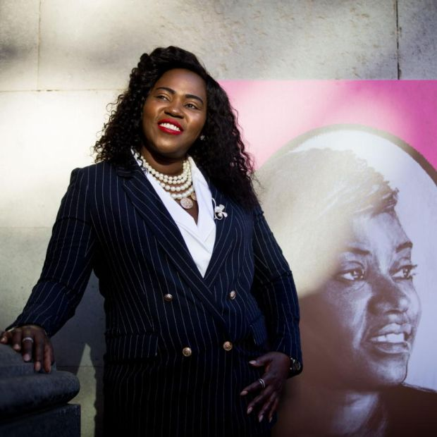 Ellie Kisyombe with the portrait of her for Dublin City Council Culture Company's Local Heroes project. Photograph: Tom Honan