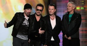 LAS VEGAS, NV - MAY 22:  Musicians The Edge, Bono, Larry Mullen Jr. and Adam Clayton of the band U2 accept the Touring Top Artist Award onstage during the 2011 Billboard Music Awards at the MGM Grand Garden Arena May 22, 2011 in Las Vegas, Nevada.  (Photo by Ethan Miller/Getty Images for ABC)