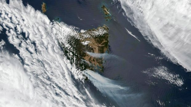 Photo from Nasa's Earth Observatory showing large fires fuelled by extremely dry and hot conditions that have been burning for almost two weeks in central and southeast Tasmania. The Tasmania Fire Service has issued several emergency warnings to residents to relocate, as dangerous fire conditions and strong wind persist. Photograph: Nasa Earth Observatory/Lauren Dauphin/EPA
