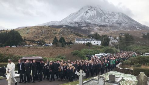 MAKING THEIR WAY: The funeral procession for Micheal Roarty approaching the Sacred Heart Church in Dunlewey, in Co Donegalon January 31st. Photograph: Michael McHugh/PA Wire