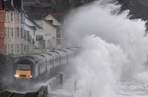 SURF'S UP: Large waves crash over a train as it passes through Dawlish, along the Dawlish Sea Wall route in southwest Britain on January 31st. Photograph: Toby Melville/Reuters