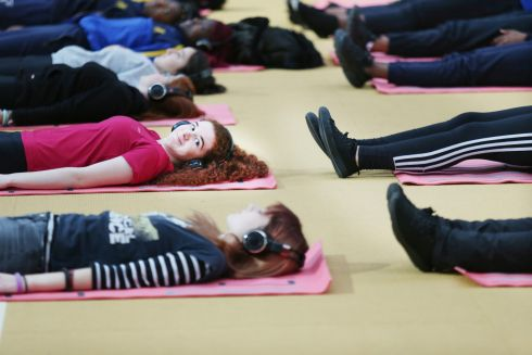 WELLBEING: Roisín Mahony from St Brigids's College, Kilkenny takes part in the yoga class at Healthfest 2019 event organised by the National Dairy Council and Safefood for transition year students. Over 3,000 students from all over Ireland attended the free event which is designed to promote health and wellbeing amongst teenagers with activities including Zumba, football and yoga with cookery demos and talks on mental health and nutrition. Photograph: Leon Farrell/Photocall Ireland