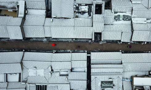 ROOFTOPS: This aerial view shows roofs covered with snow in Yangzhou in China's eastern Jiangsu province on January 31st. Photograph: STR/AFP/China OUTSTR/Getty
