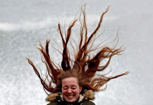 WINDSWEPT: A woman reacts as her hair blows in the air on windy day in San Sebastian, in the Basque sountry, northern Spain on January 31st. The Basque Department of Security has issued an orange-level alert due to bad sea with waves reaching up to 6 meters high. Photograph: Juan Herrero/EPA