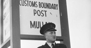 A member of the Royal Ulster Constabulary (RUC) stands guard at a customs boundary post in Northern Ireland, 1961. Photograph: Keystone Features/Getty Images
