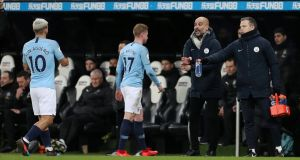 City's Kevin De Bruyne walks toward manager Pep Guardiola during his substitution at  St James' Park, Newcastle. Photograph: Reuters/Lee Smith