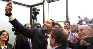Lebanese prime minister Saad al-Hariri  takes a selfie with journalists at the Presidential Palace in east Beirut, Lebanon, on Thursday.  Photograph: Wael Hamzeh