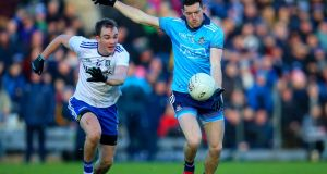 Dublin's Ryan Basquel in action against  Jack McCarron of Monaghan at Clones. Photograph: Tommy Dickson/Inpho