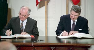 December 1987: Soviet general secretary Mikhail Gorbachev and US president Ronald Reagan signing the INF treaty, in Washington. The US on Friday announced its intention to withdraw from the treaty because of Russia's violation. Photograph: EPA