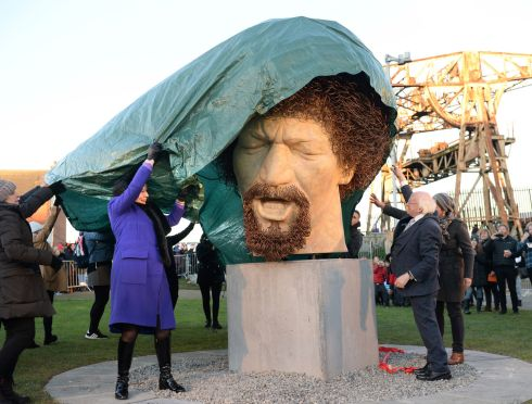 LUKE AHEAD: President Michael D Higgins and his wife Sabina unveil a sculpture of Luke Kelly in Guild Street, Dublin. Photograph: Dara Mac Dónaill/The Irish Times