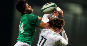 Ireland's Conor Phillips and Cadan Murley of England challenge for the ball during the Under-20 Six Nations match at Musgrave Park. Photograph: Laszlo Geczo/Inpho