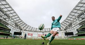 John Cooney practising his kicking during the Ireland captain's run at the Aviva stadium ahead of the England game. Photograph: Dan Sheridan/Inpho
