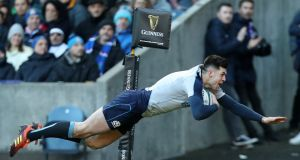 Scotland's Blair Kinghorn touches down for one of his three tries  against Italy at Murrayfield. Photograph: Ian MacNicol/Getty Images