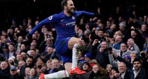 Chelsea's Gonzalo Higuain celebrates after scoring against Huddersfield during the  Premier League  match at Stamford Bridge. Photograph: Will Oliver/EPA