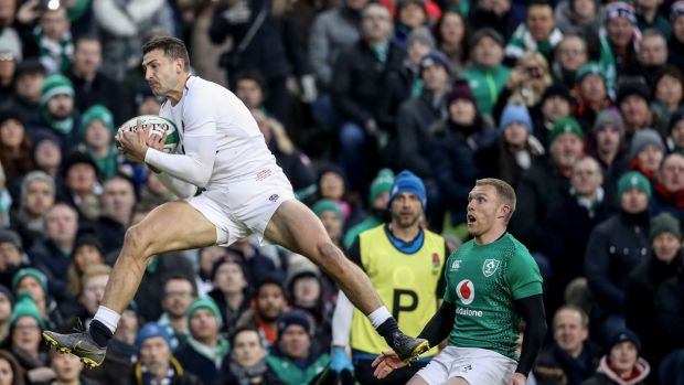 England's Jonny May catches the ball ahead of Ireland's Keith Earls during the Six Nations match at the Aviva stadium. Photograph: Billy Stickland/Inpho