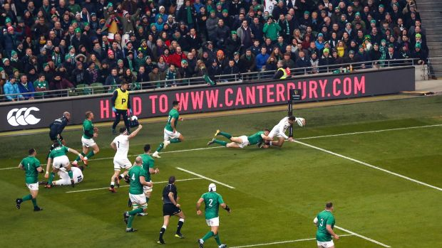 England's Jonny May goes over in the corner for his side's first try in the Six Nations match against Ireland at the Aviva stadium. Photograph: James Crombie/Inpho