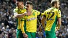 Ben Godfrey, Max Aarons and Teemu Pukki celebrate Norwich City's second goal in their win over Leeds. Photograph: George Wood/Getty