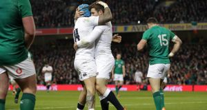 England's Jack Nowell celebrates with try scorer Elliot Daly during the Six Nations game against Ireland at the Aviva stadium. Photograph: Billy Stickland/Inpho