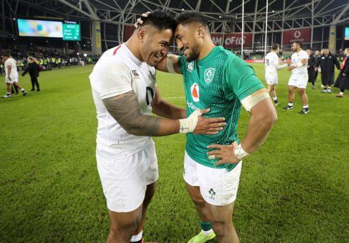Ireland's Bundee Aki with England's Manu Tuilagi after the game  Photo: INPHO/Billy Stickland