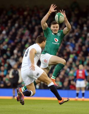 Ireland's Jacob  Stockdale and and England's Ben Youngs Photo: Tom Honan for The Irish Times.