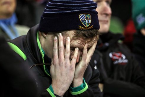 An Ireland fan dejected late in the game Photo: INPHO/Dan Sheridan