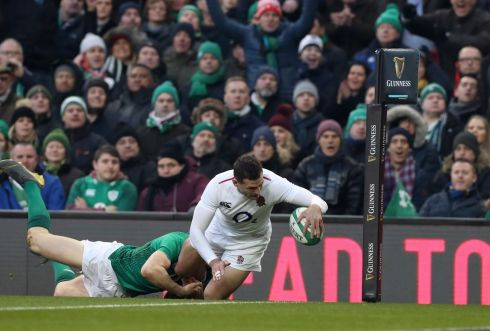 England's Jonny May scores their first try despite Garry Ringrose of Ireland  Photo: INPHO/Billy Stickland