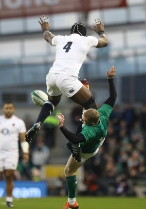 Ireland's Keith Earls and England's Maro Itoje compete for a high ball during the Guinness Six Nations match at the Aviva Stadium. Photo: Lorraine O'Sullivan/PA Wire.