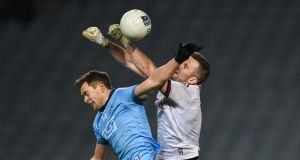 Galway goalkeeper Mághnus Breathnach challenges Dublin's Dean Rock during the Allianz Football League Division 1 match at  Croke Park. Photograph:  Tommy Grealy/Inpho