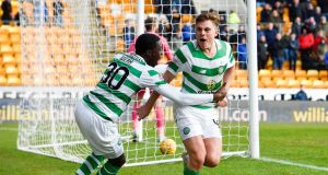 James Forrest and Timothy celebrate Celtic's first goal against St Johnstone. Photograph: Ian Rutherford/PA