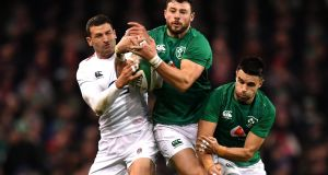 Ireland fullback Robbie Henshaw competes for the ball  with England's Jonny May during the Six Nations match at the Aviva stadium. Photograph:   Dan Mullan/Getty Images