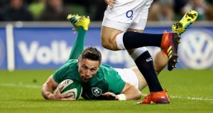 John Cooney scores a late consolation try for Ireland in the Six Nations game against England at the Aviva stadium. Photograph: James Crombie/Inpho