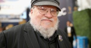 "George RR Martin's  latest release isn't a novel but rather an ""imaginary history"". Photograph:    Christopher Polk/Getty Images"