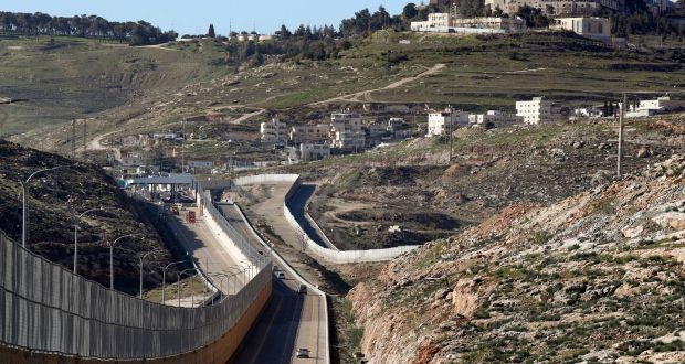 "A new Israeli road divided into a side for Palestinians and another to be used exclusively by Israelis and settlers, in East Jerusalem. Dubbed the ""Apartheid Road"", it is divided by an 8m-high wall. File photograph: Thomas Coex/AFP/Getty"