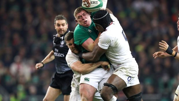 Tadhg Furlong's progress is halted by the combined tackles from England's Mark Wilson and Maro Itoje during the Six Nations clash at the Aviva Stadium. Photograph: Billy Stickland/Inpho