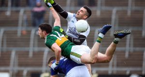 Cavan goalkeeper  Raymond Galligan challenges  Kerry's Paul Geaney during the Allianz Football League Division 1 match at  Kingspan Breffni Park. Photograph: John McVitty/Inpho