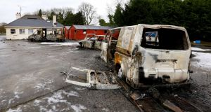 Burned-out vans and cars at the scene of the Strokestown eviction late last year. Photograp: Brian Farrell