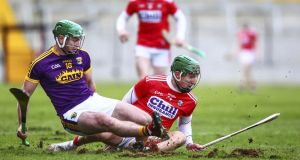 Wexford's Darren Byrne and Cork's Aidan Walsh in action at Pairc Ui Chaoimh. Photograph: Ken Sutton/Inpho
