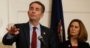 Virginia governor  Ralph Northam with  his wife, Pamela, at a news conference in the Governor's Mansion at the Capitol in Richmond on Saturday. Photograph: Steve Helber/AP