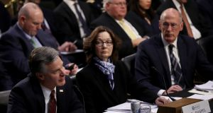 "FBI director Christopher Wray, CIA director Gina Haspel and director of national intelligence Dan Coats testify at a Senate intelligence committee hearing on ""worldwide threats"" last Tuesday in Washington. Photograph: Win McNamee/Getty Images"