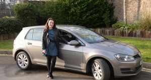 Niamh Towey, with her new car in Dublin. Photograph: Dara Mac Dónaill